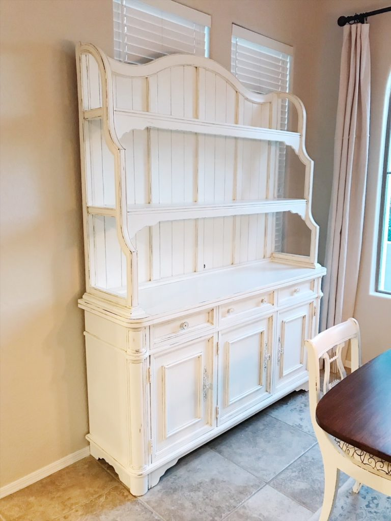 This dining room hutch is everything I hoped it would be. I love the color combination of Annie Sloan Old White and Pure White . It's a beautiful creamy white with just enough distressing to give it a bit of time-worn look.
