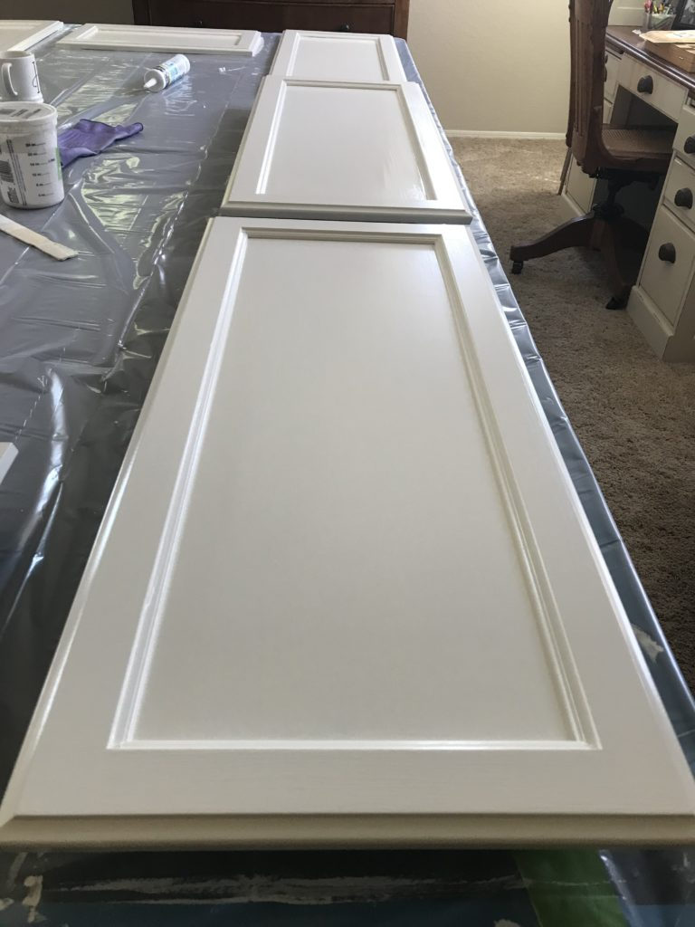 I love the warm creamy white that Dover White is!  This is my favorite color ever  for kitchen cabinets as well other furniture makeovers.