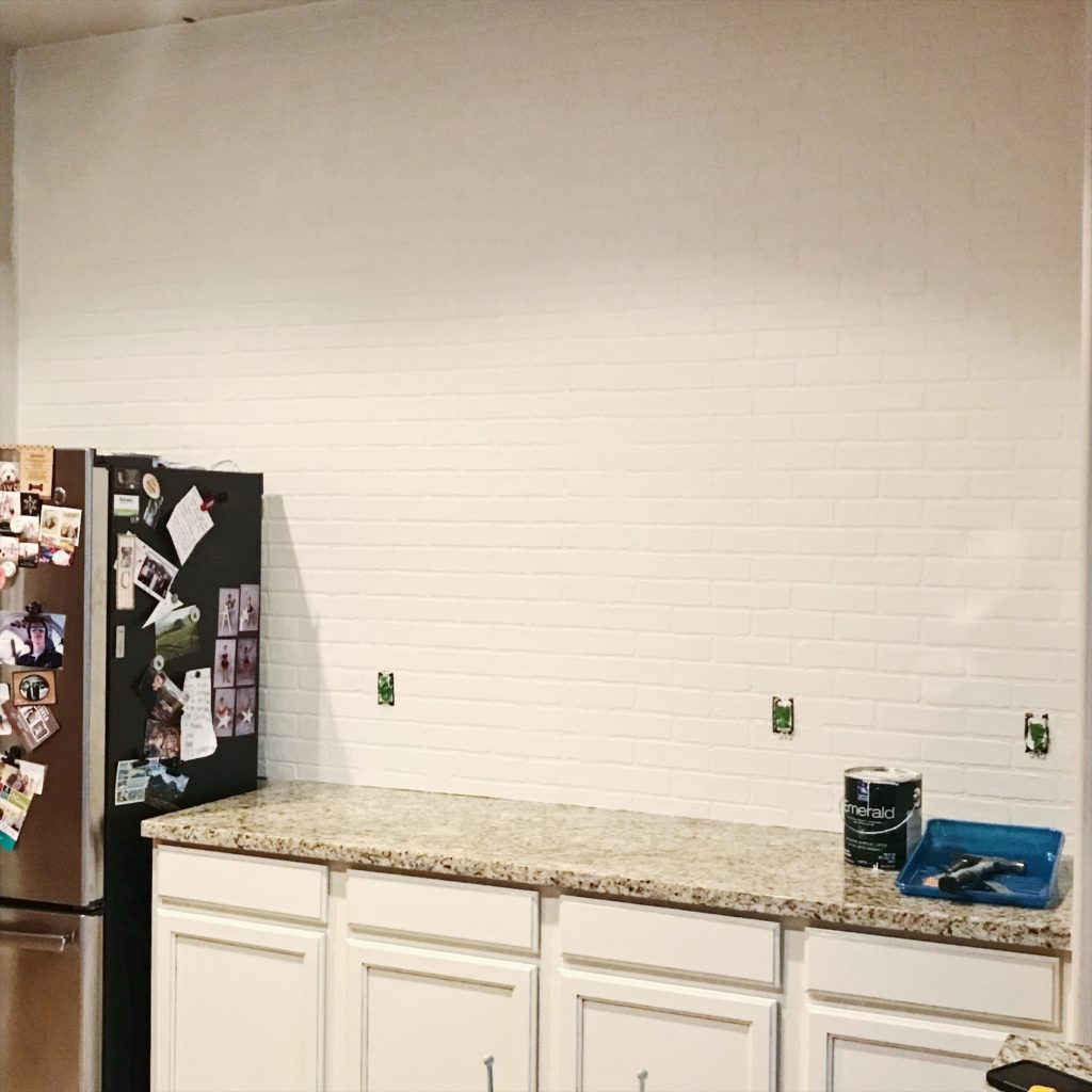 I love how this white brick wall turned out.  Using Brick Panels , Joint compound and white paint makes this a pretty simple makeover.