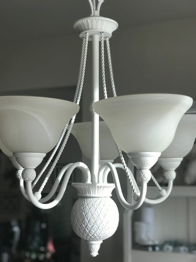 Chandelier Makeover using Rustoleum spray paint in French Cream, updates this chandelier from drab to fab.