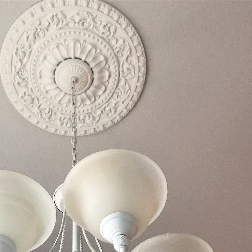 A ceiling medallion is the perfect touch to complete a chandelier makeover. This medallion from udecor.com is elegant and high quality.