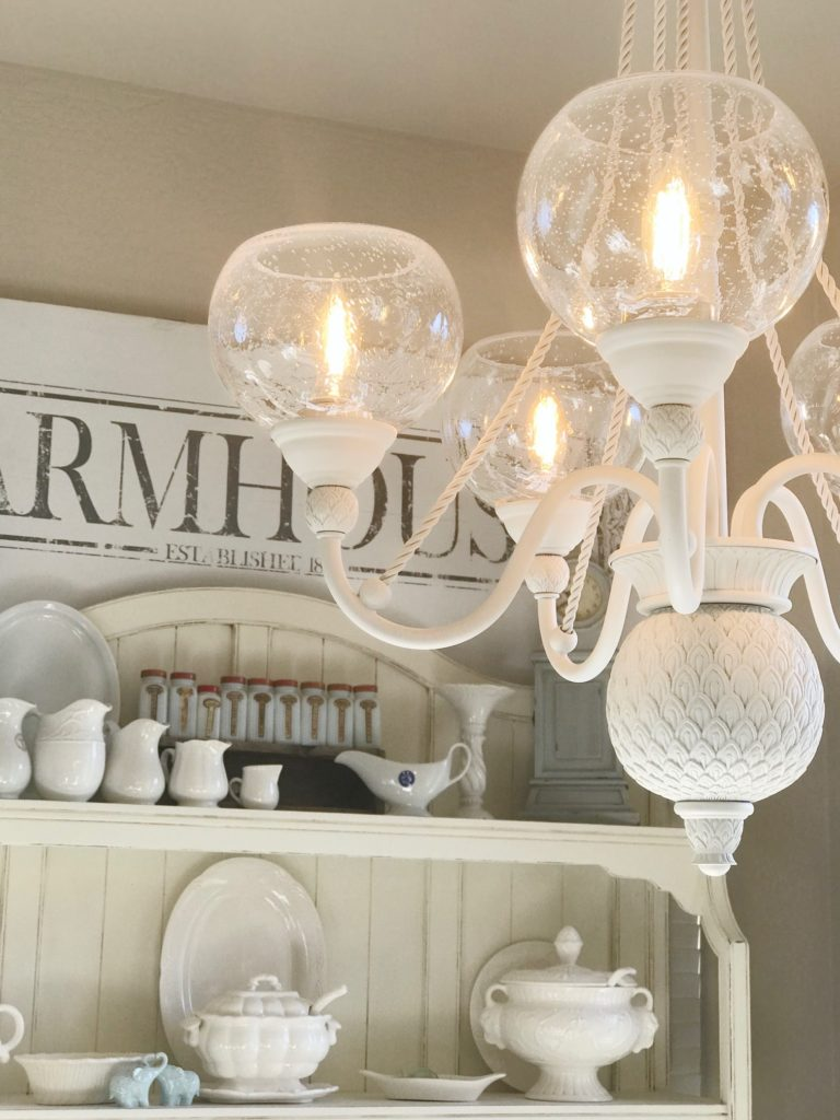 This chandelier got a fabulous makeover with rustoleum spray paint and new seeded globes from Lowes. What a great transformation.