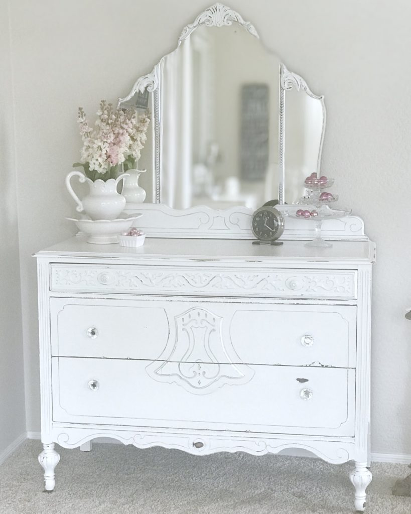 This vintage dresser has received a fabulous makeover with paint, new hardware, and fabric lining in the drawers. She feels so pretty now!
